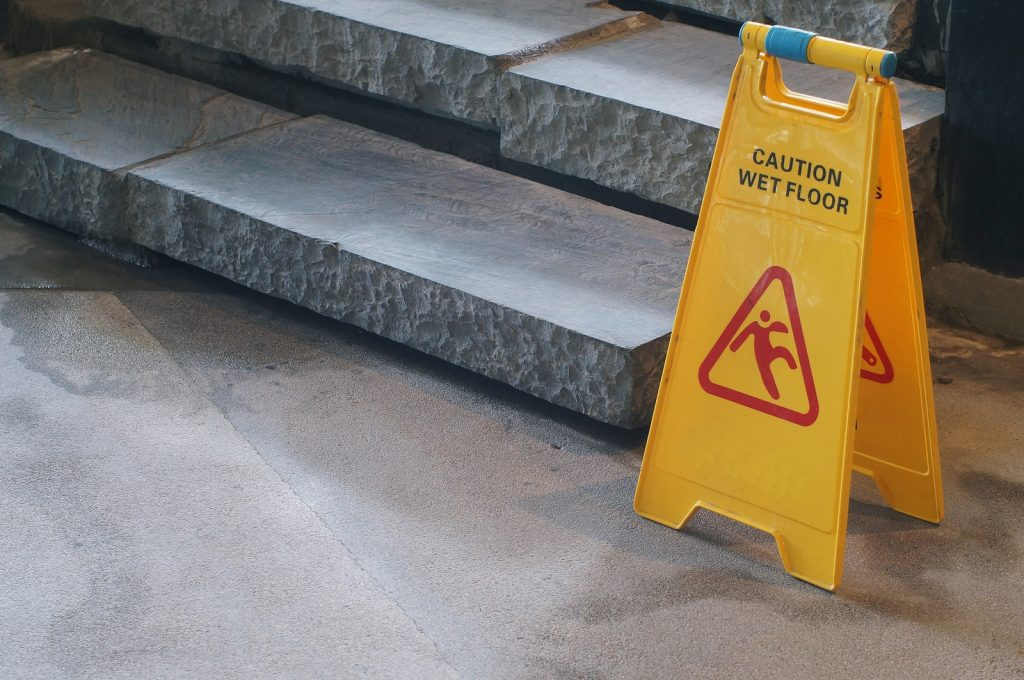 caution slippery floor sign to prevent slip and fall accidents